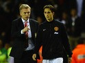 David Moyes of Manchester United talks with Adnan Januzaj after victory in the Barclays Premier League match between Sunderland and Manchester United at Stadium of Light on October 5, 2013