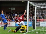 Lee Collins of Northampton Town celebrates scoring the first goal during the Sky Bet League Two match between AFC Wimbledon and Northampton Town at the Cherry Red Records Stadium on October 5, 2013