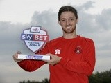 UNDER EMBARGO UNTIL 6AM 4/10/13: Leyton Orient striker David Mooney with his League One Player of the Month Award for September, on October 3, 2013