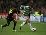 Celtic's Giorgos Samaras and Barcelona's Marc Bartra battle for the ball during their Champions League group match on October 1, 2013