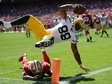 Green Bay's Jermichael Finley scores a touchdown against San Francisco on September 8, 2013