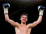 British boxer Luke Campbell celebrates his victory over Andy Harris on July 13, 2013