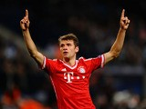 Thomas Müller of Bayern Munich celebrates scoring against Manchester City during the Champions League match on October 2, 2013