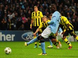 Mario Balotelli of Manchester City scores an equalising penalty kick during the UEFA Champions League Group D match between Manchester City and Borussia Dortmund at the Etihad Stadium on October 3, 2012