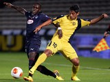 Bordeaux's Maxime Poudje and Maccabi's Barak Itzhaki battle for the ball during their Europa League group match on October 3, 2013