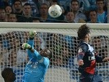 Paris Saint-Germain defender Maxwell heads the ball and scores against Marseille during the Ligue 1 match on October 6, 2013