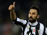 Mirko Vucinic of Juventus celebrates scoring the first goal during the Serie A match against Bologna at Stadio Renato Dall'Ara on March 16, 2013