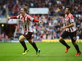 Craig Gardner of Sunderland celebrates scoring the opening goal with Ondrej Celustka during the Barclays Premier League match between Sunderland and Manchester United at the Stadium of Light on October 5, 2013