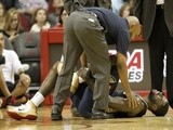 Tyreke Evans of the New Orleans Pelicans lays on the floor with a hurt ankle against the Houston Rockets in a preseason NBA game on October 5, 2013