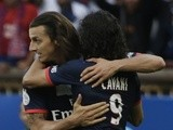 PSG strikers Zlatan Ibrahimovic and Edinson Cavani celebrate a goal by the former against Guingamp on August 31, 2013