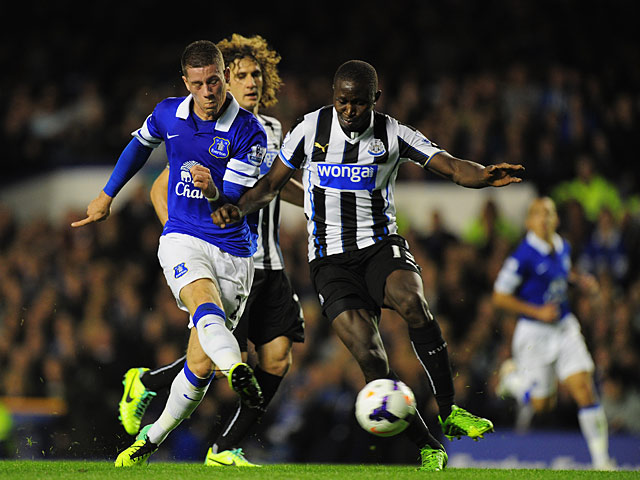 Everton's Ross Barkley scores his team's second goal against Newcastle during their Premier League match on September 30, 2013