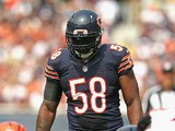 D.J. Williams #58 of the Chicago Bears awaits the snap against the Cincinnati Bengals at Soldier Field on September 8, 2013