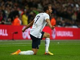 Andros Townsend of England celebrates scoring their third goal during the FIFA 2014 World Cup Qualifying Group H match between England and Montenegro at Wembley Stadium on October 11, 2013
