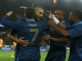 Karim Benzema of France is mobbed by team mates after scoring the sixth goal during the International Friendly match between France and Australia at Parc des Princes on October 11, 2013