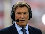 Former England manager Glenn Hoddle is interviewed for British televison ahead of the UEFA Champions League football match between Benfica and Chelsea at Estadio da Luz in Lisbon, on March 26, 2012