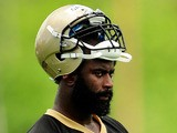 Junior Galette #93 of the New Orleans Saints watches action during organized team activities at the Saints training facility on May 23, 2013