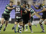 Jimmy Stevens of London Irish is tackled by Jacapo Zucconi of Cavalieri during the Amlin Challenge Cup match between London Irish and Cavalieri Prato at Madejski Stadium on October 11, 2013