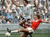 England's Terry Butcher slide tackles France's Michel Platini in 1982.