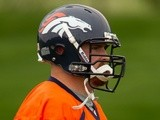 Mike Remmers of the Denver Broncos jogs during rookie camp at Dove Valley on May 11, 2012