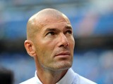 Real Madrid's French assistant coach Zinedine Zidane looks on before the Spanish league football match Real Madrid CF vs Real Betis at the Santiago Bernabeu stadium in Madrid on August 18, 2013