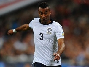 Ashley Cole of England runs with the ball during the FIFA 2014 World Cup Qualifying Group H match between England and Moldova at Wembley Stadium on September 6, 2013
