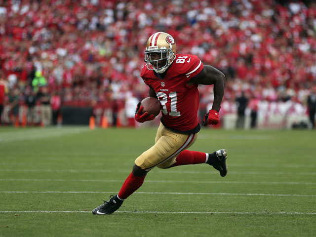 Wide receiver Anquan Boldin #81 of the San Francisco 49ers carries the ball against the Houston Texans at Candlestick Park on October 6, 2013