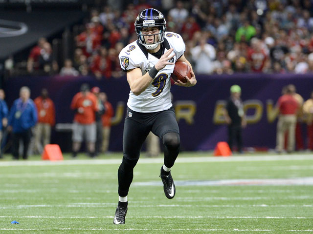 Justin Tucker #9 of the Baltimore Ravens attempts a fake field goal as he runs the ball against the San Francisco 49ers during Super Bowl XLVII at the Mercedes-Benz Superdome on February 3, 2013