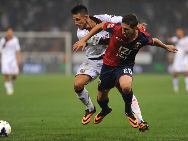 Sime Vrsaljko of Genoa CFC competes with Leandro Greco of AS Livorno Calcio during the Serie A match between Genoa CFC and AS Livorno Calcio at Stadio Luigi Ferraris on September 21, 2013
