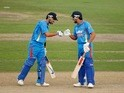 Rohit Sharma (L) and Virat Kohli (R) of India bump fists during the one day tour match between Sussex and India at The County Ground on August 25, 2011