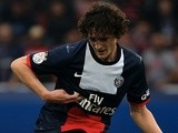 Paris Saint-Germain's French midfielder Adrien Rabiot passes the ball during the French L1 football match between Paris Saint-Germain and Toulouse on September 27, 201