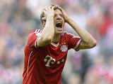 Bayern Munich's striker Thomas Muller reacts during the German first division Bundesliga football match between FC Bayern Munich and FSV Mainz 05 on October 19, 2013