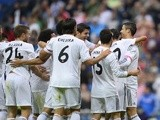 Real Madrid's Portuguese forward Cristiano Ronaldo celebrates with teammates after scoring during the Spanish league football match Real Madrid vs Malaga on October 19, 2013
