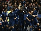 France's players celebrate after midfielder Franck Ribery scored a goal during the 2014 FIFA World Cup qualifying group I football match between France and Finland on October 15, 2013