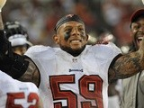 Linebacker Mason Foster of the Tampa Bay Buccaneers celebrates after running an interception back for a touchdown in the 4th quarter against the New Orleans Saints on September 15, 2013