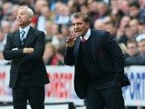 Manager Alan Pardew of Newcastle United and Manager Brendan Rodgers of Liverpool give instructions from the touchline during the Barclays Premier League match between Newcastle United and Liverpool at St James' Park on October 19, 2013