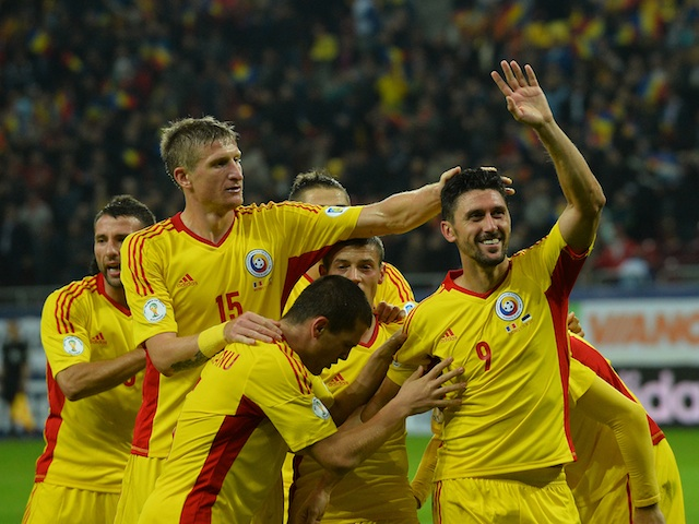 Ciprian Marica of Romania celebrates scoring the second goal with his teammates during the FIFA 2014 World Cup group D qualifying football match against Estonia on October 15 2013