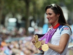 British Paralympic gold medal winning cyclist Sarah Storey waves to the crowd during the London 2012 Victory Parade on September 10, 2012