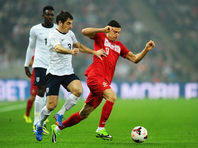 Robert Lewandowski of Poland is challenged by Leighton Baines of England during the FIFA 2014 World Cup Qualifying Group H match on October 15, 2013