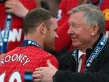Alex Ferguson congratulates Wayne Rooney upon winning the Premier League title in May 2013.