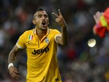 Juventus' Chilean midfielder Arturo Erasmo Pardo Vidal argues with German referee Manuel Grafe during the UEFA Champions League Group B football match against Real Madrid on October 23, 2013