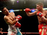 Brian Rose in action with Javier Maciel during their Final Eliminator for WBO World Light Middleweight Championship bout at Motorpoint Arena on October 26, 2013
