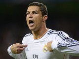 Real Madrid's Portuguese forward Cristiano Ronaldo celebrates after scoring during the UEFA Champions League Group B football match Real Madrid CF vs Juventus on October 23, 2013