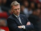 A dejected Manager David Moyes of Manchester United looks on during the Barclays Premier League match between Manchester United and Stoke City at Old Trafford on October 26, 2013
