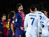 Gerard Pique and Cristiano Ronaldo exchange views during the Copa del Rey semi-final in February 2013.