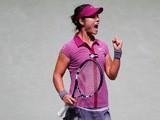 Li Na celebrates her win over Petra Kvitova during their WTA Championships match on October 26, 2013