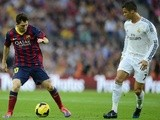 Barcelona's Argentinian forward Lionel Messi vies with Real Madrid's Portuguese forward Cristiano Ronaldo during the Spanish league Clasico football match on October 26,
