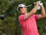 Luke Guthrie of the USA hits his tee-shot on the 16th hole during the second round of the BMW Masters at Lake Malaren Golf Club on October 25, 2013