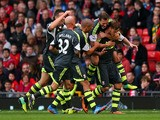 Marko Arnautovic of Stoke City is mobbed by team mates after scoring from a free kick during the Barclays Premier League match against Manchester United on October 26, 2013