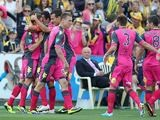 Central Coast Mariners' Nicholas Fitzgerald is congratulated by team mates after scoring the opening goal against Adelaide United on October 26, 2013