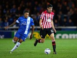 Nathaniel Knight-Percival of Peterborough in action with Conor Coady of Sheffield United during the Sky Bet League One match between Peterborough United and Sheffield United at London Road Stadium on October 22, 2013